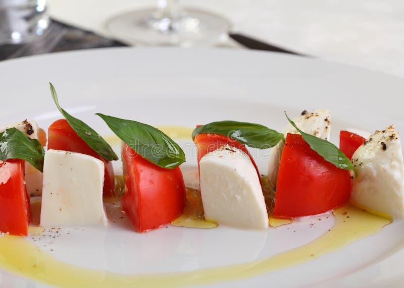 Caprese Mozzarella and tomatoes royalty free stock image