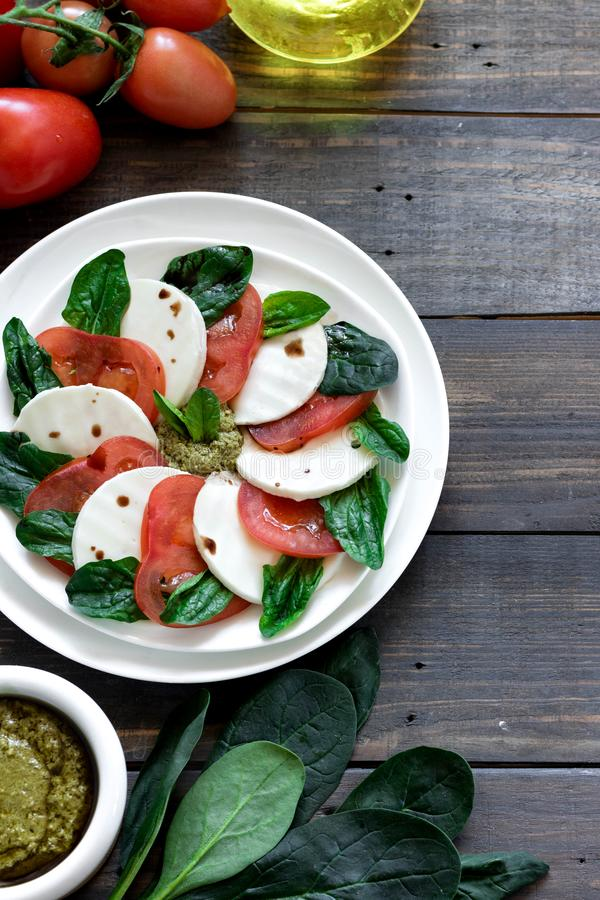 Caprese salad with pesto and balsamic vinegar stock photo