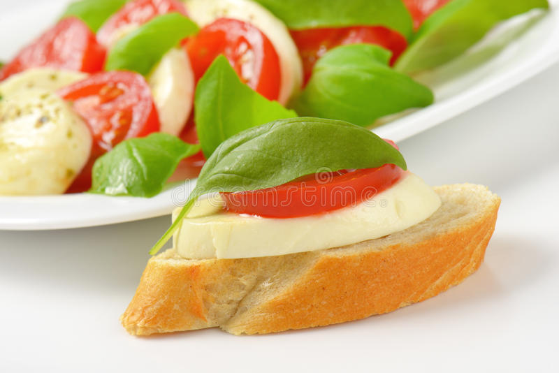 Caprese salad with sandwich stock photography