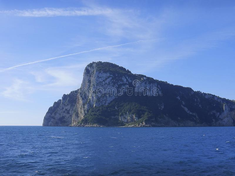The isle of Capri in the Bay of Naples Italy. Capri is an Italian island off the Sorrentine Peninsula, on the south side of the Bay of Naples. It has been a royalty free stock images
