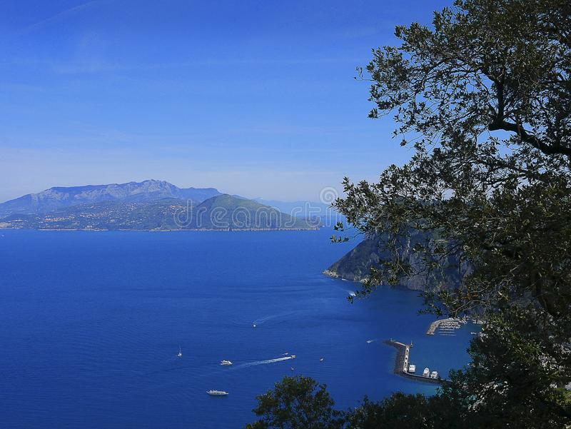 View of the Sorrento peninsular from the isle of Capri Italy. Capri is an Italian island off the Sorrentine Peninsula, on the south side of the Gulf of Naples stock images