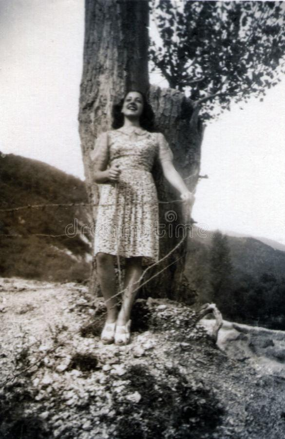 Capri, Italy, 1932 - A girl smiles cheerfully on a spring day royalty free stock image