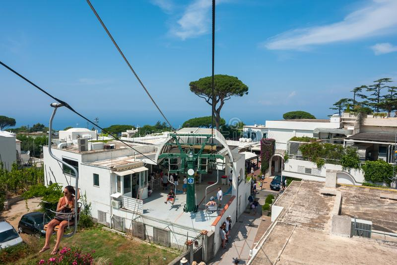 Capri lift. CAPRI, ITALY: Tourists riding up the mountain lift. Capri is a popular tourist destination and an island of Italy stock images