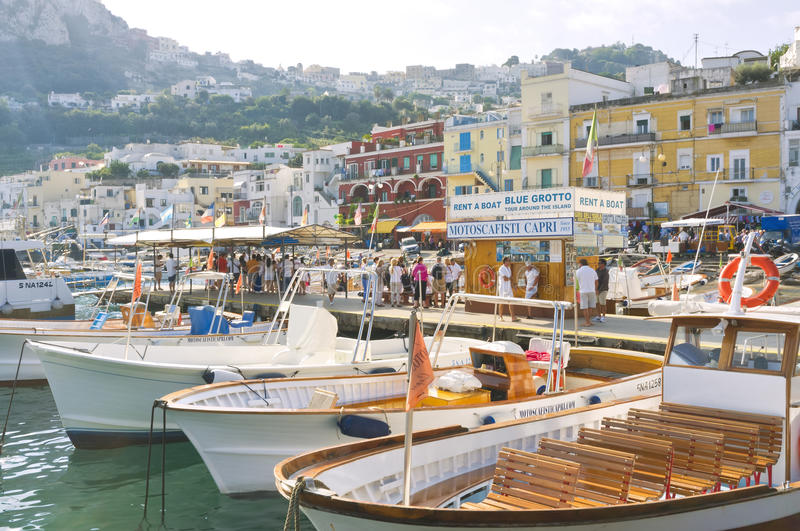 Capri Marina, Amalfi Coast, Italy. Small boats line the shore as people gather in the morning after taking ferries over from the mainland of Italy for tours and royalty free stock photos