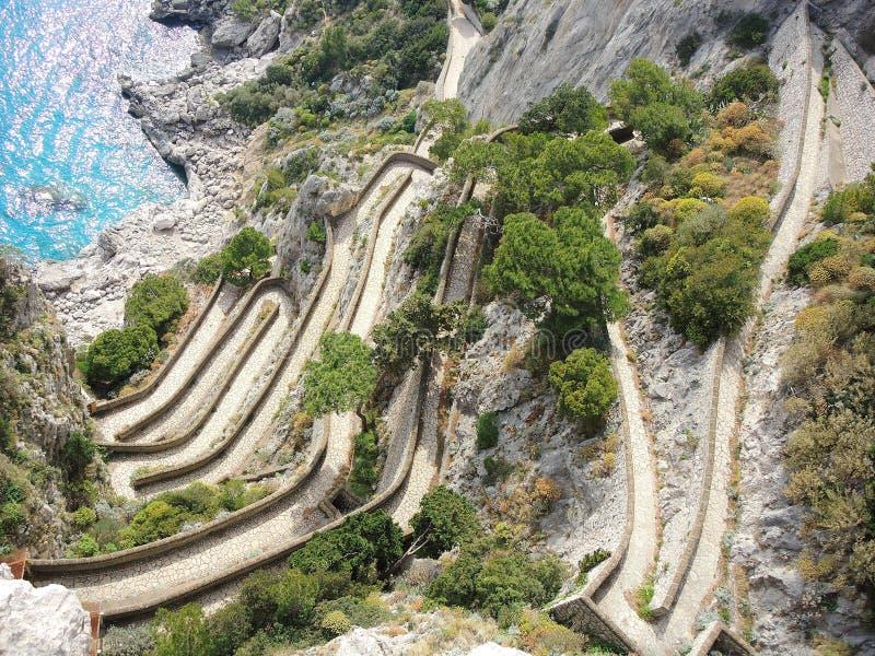 Capri, Włochy, Przez Krupp Ja jest historycznym brukującym footpath fotografia royalty free