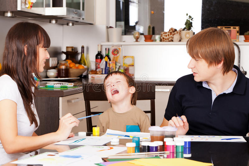 Capricious boy. Don't want to paint with parents stock photos