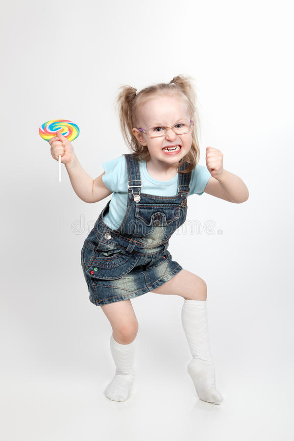 Free Capricious Little Girl With Lollipop Royalty Free Stock Image - 24444636