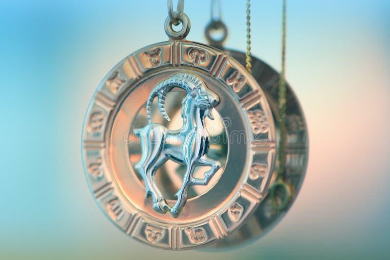 Capricorn symbol necklace. Capricorn symbol golden necklace macro view stock image