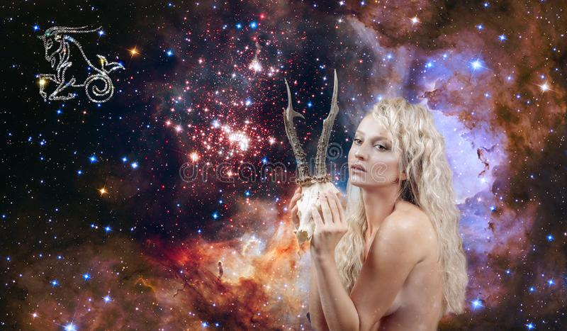 Capricorn Zodiac Sign. Astrology and horoscope, Beautiful woman Capricorn on the galaxy background stock photography