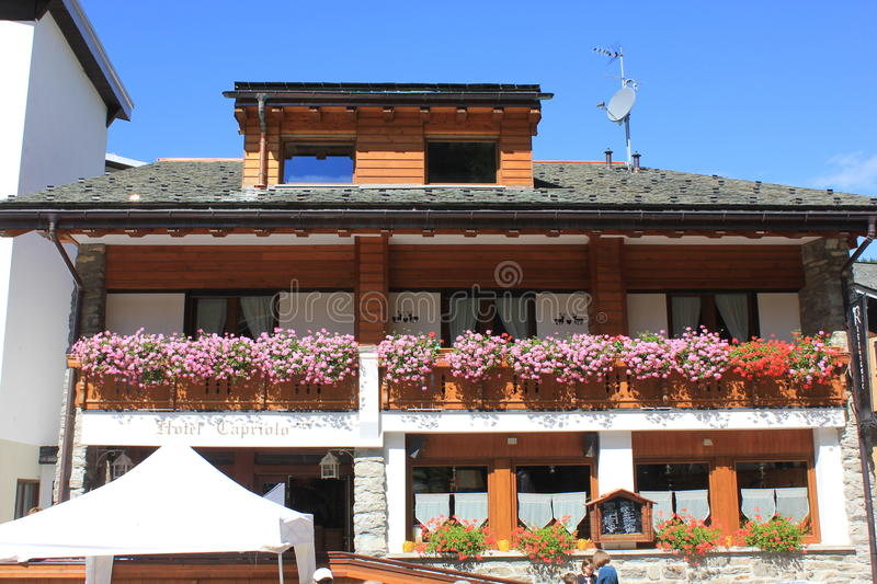 Capriolo bed and breakfast hotel. MADESIMO, ITALY - AUG 21 2014: Capriolo bed and breakfast hotel and restaurant in Madesimo city centre in summer, with flowers royalty free stock images