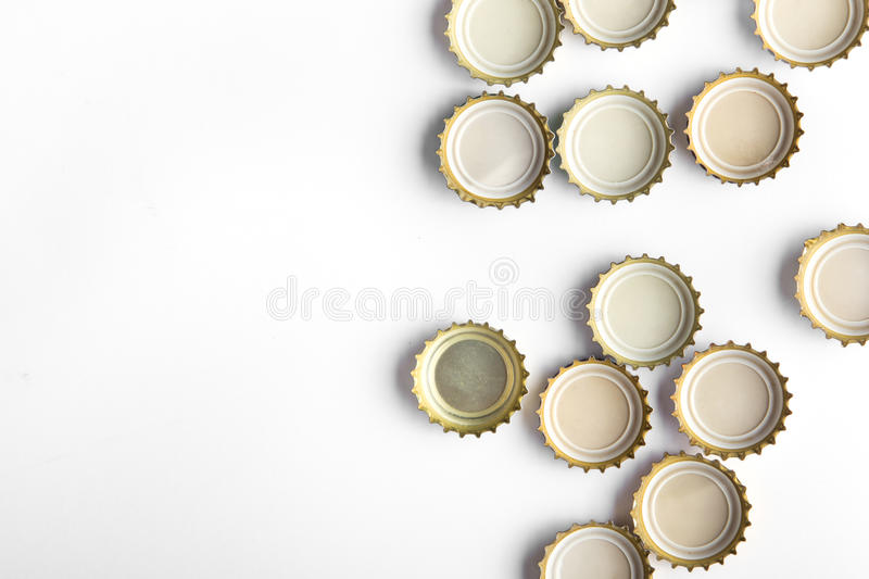 Caps of beer on white background. There is a place for an inscription, top view royalty free stock images
