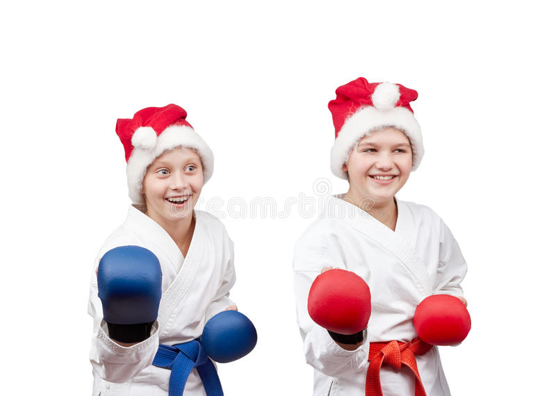 In caps of Santa Claus and with overlays on hands the athletes stand in rack royalty free stock images
