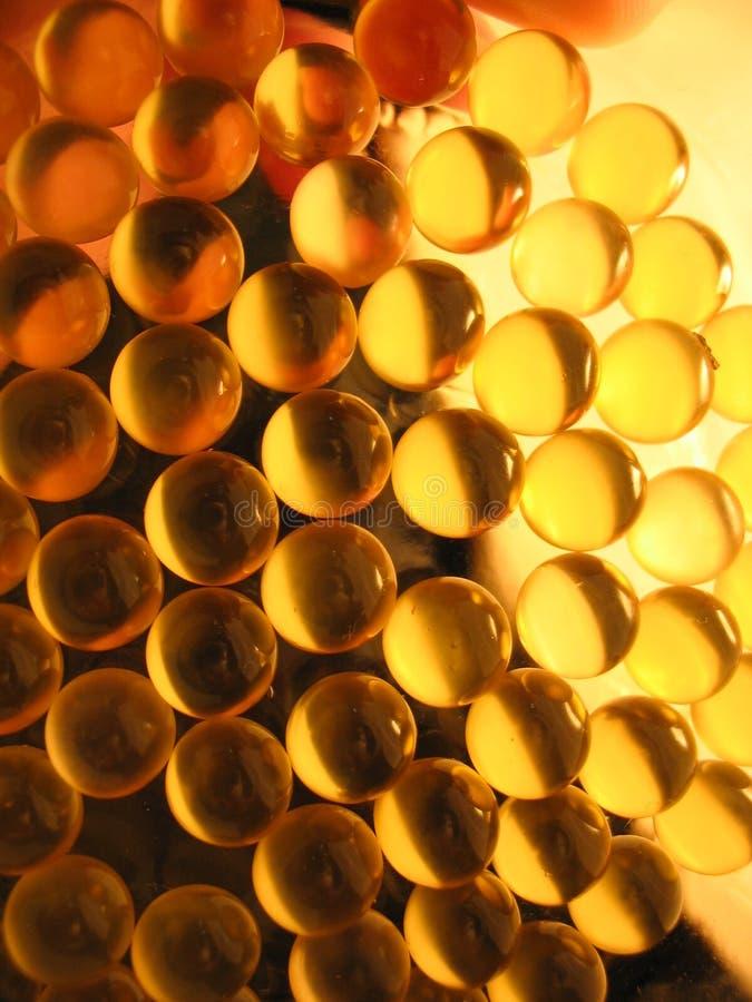Capsule dell'oro immagini stock libere da diritti