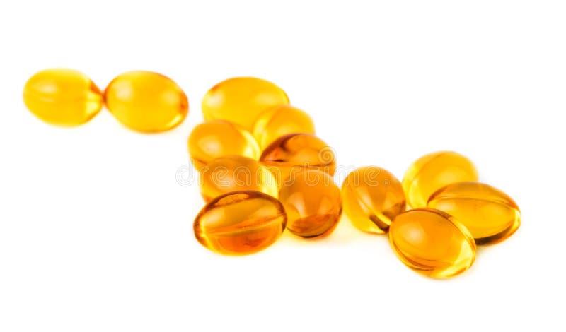 Capsule della vitamina E su bianco fotografie stock