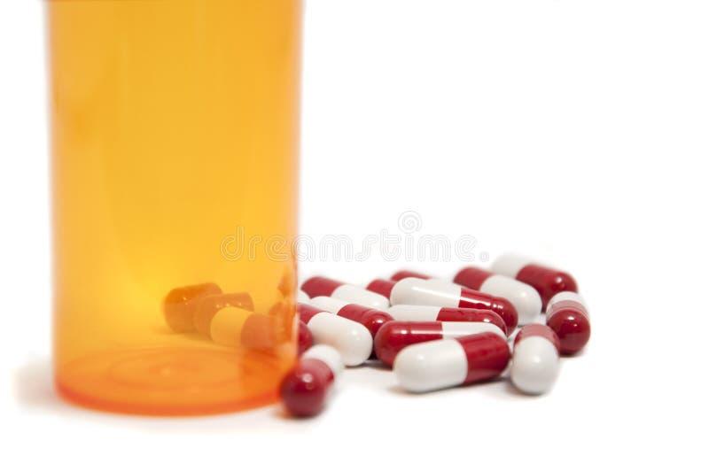 capsules красная белизна стоковое изображение