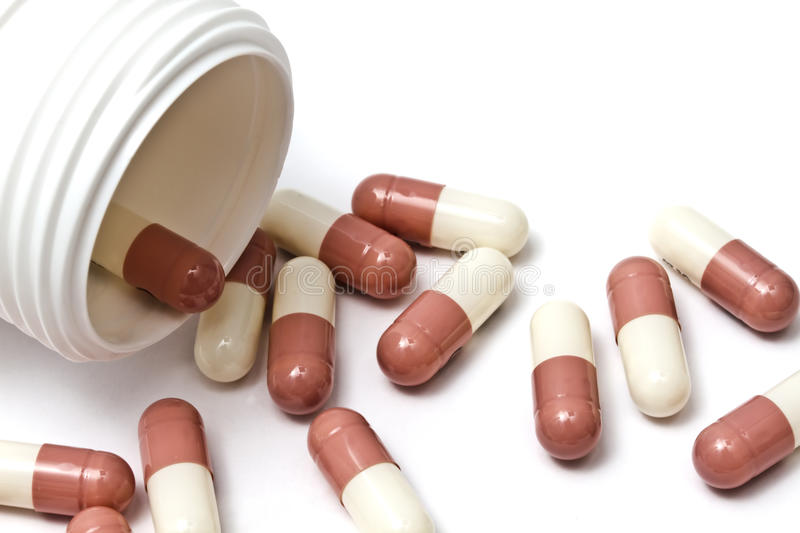 Capsules and bottle stock photography
