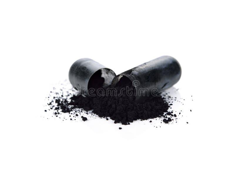 Capsules de charbon de bois photo libre de droits
