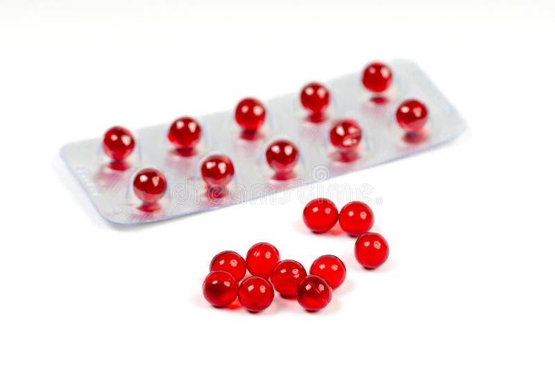 Capsules de la vitamine e et habillage transparent photographie stock