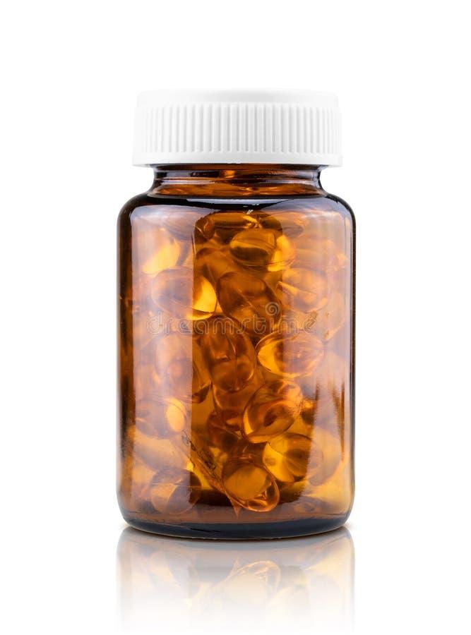 Capsules de supplément diététique d'huile de poisson dans la bouteille en verre brune photos libres de droits