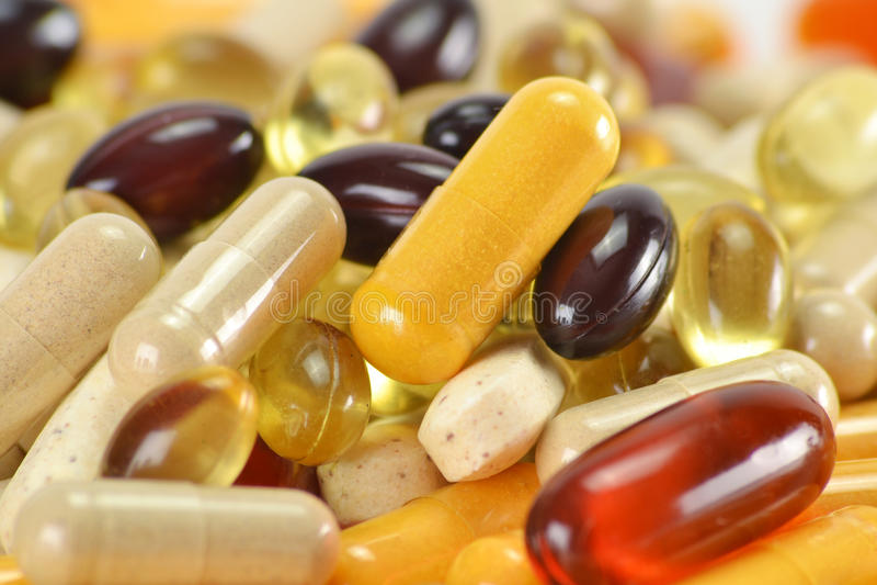 Capsules diététiques de supplément images stock