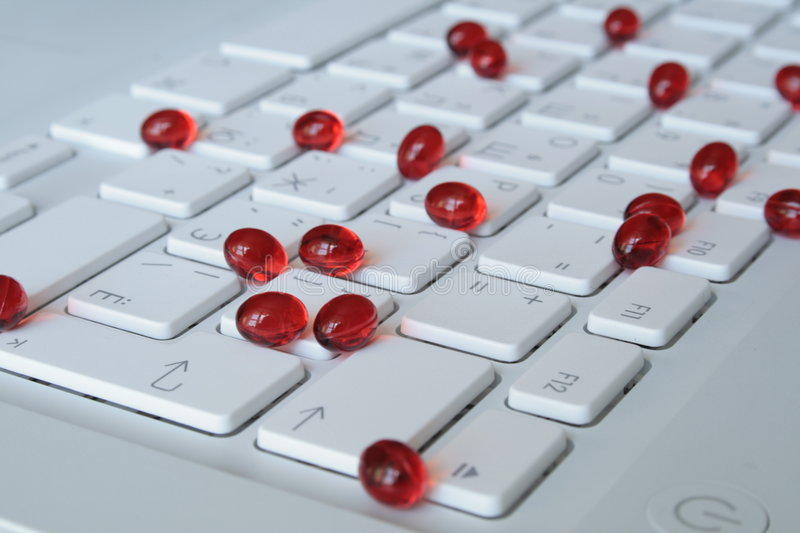 Download Capsules On The Keyboard Royalty Free Stock Photos - Image: 2587748