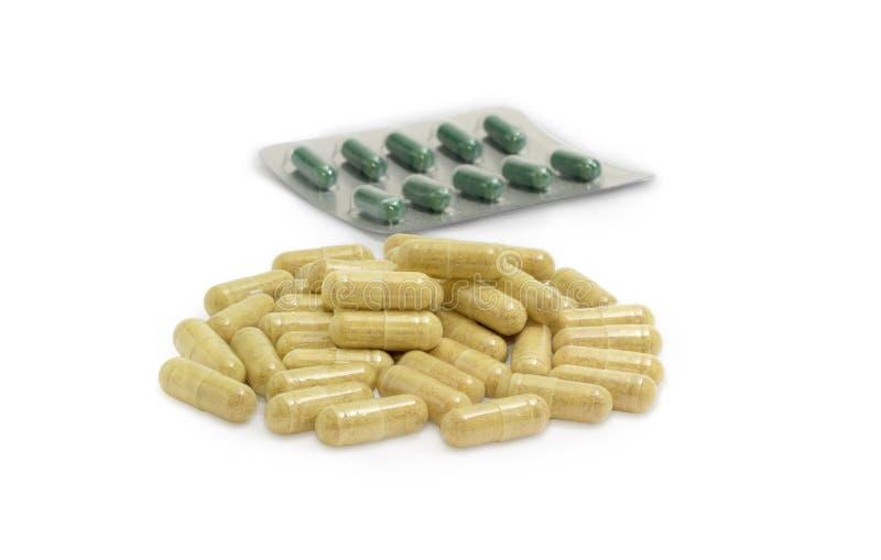 Capsules met dieetsupplementen tegen blaarpak met medi stock foto