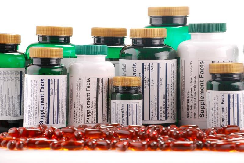Capsules van dieetsupplementen en containers royalty-vrije stock afbeeldingen