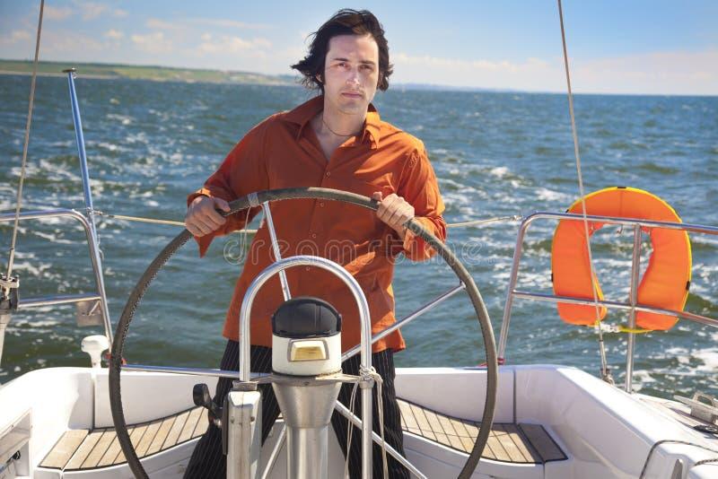 captain детеныши парусника человека стоковые изображения rf