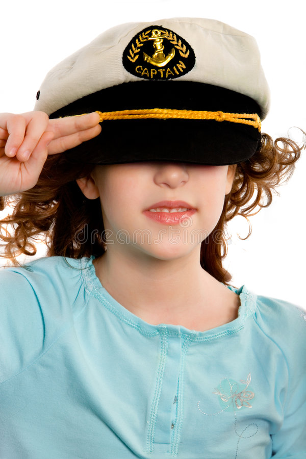 Captain. Girls in marine cap to salute stock photography