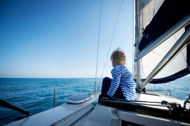 Captain for a day. A 4 year old boy on a yacht stock images