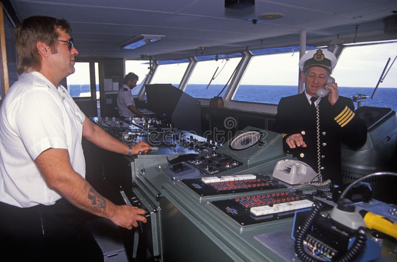 The captain of the ferry Bluenose speaking on the bridge phone while a crew member navigates the boat, Yarmouth, Nova Scotia royalty free stock photography