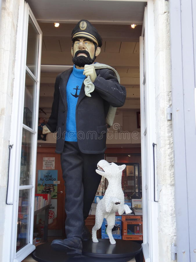 Captain Haddock. Tintin's shop in the island of saint Maurice (France). The famous Captain Haddock standing on the window with Milou, the dog of Tintin. We see stock image