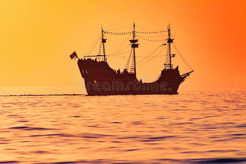 Captain Memo`s Pirate Cruise on colorful sunset background in Gulf Coast Beaches. stock photo