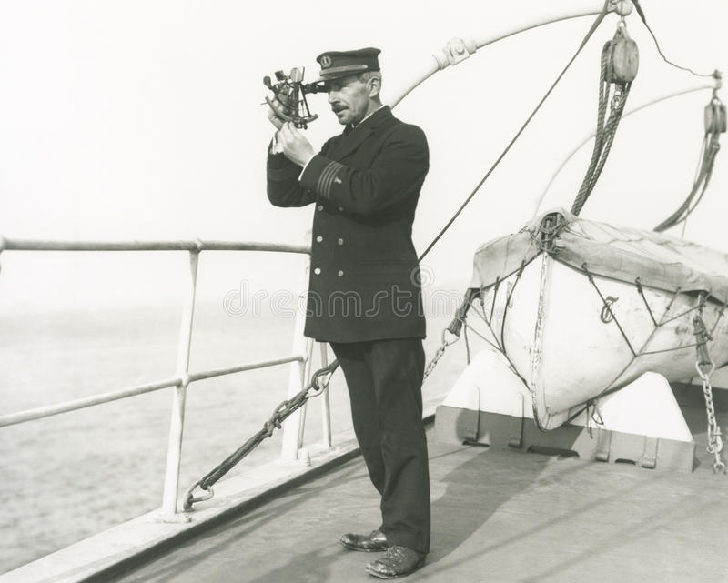 Captain navigating ship stock photos