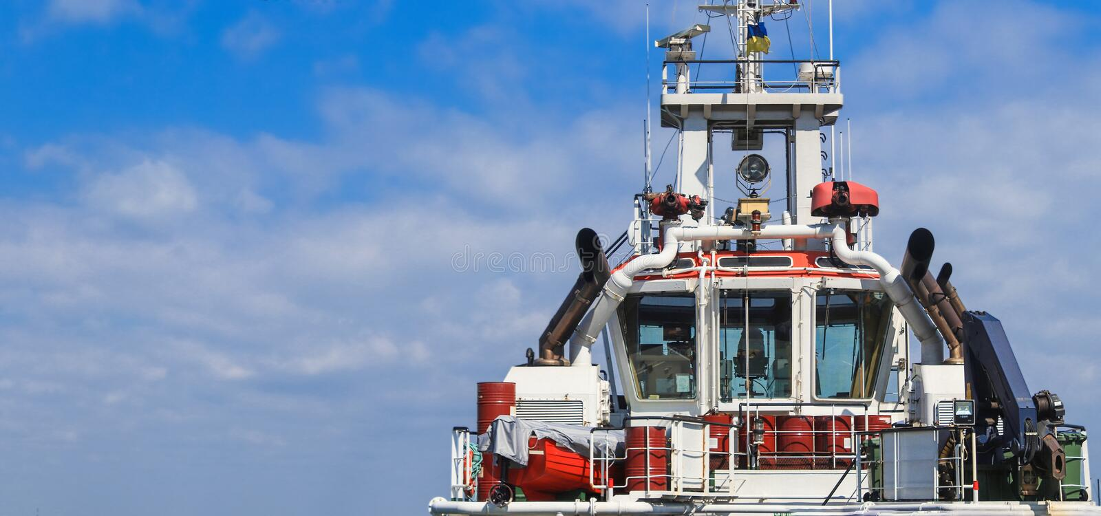 Captain`s bridge on the ship. Tug is at the pier in the sea port. Panoramic view royalty free stock photos