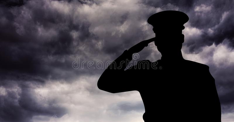 Captain silhouette saluting against storm clouds royalty free stock photo