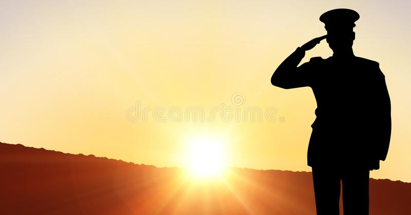 Captain silhouette saluting against sunset royalty free stock photos