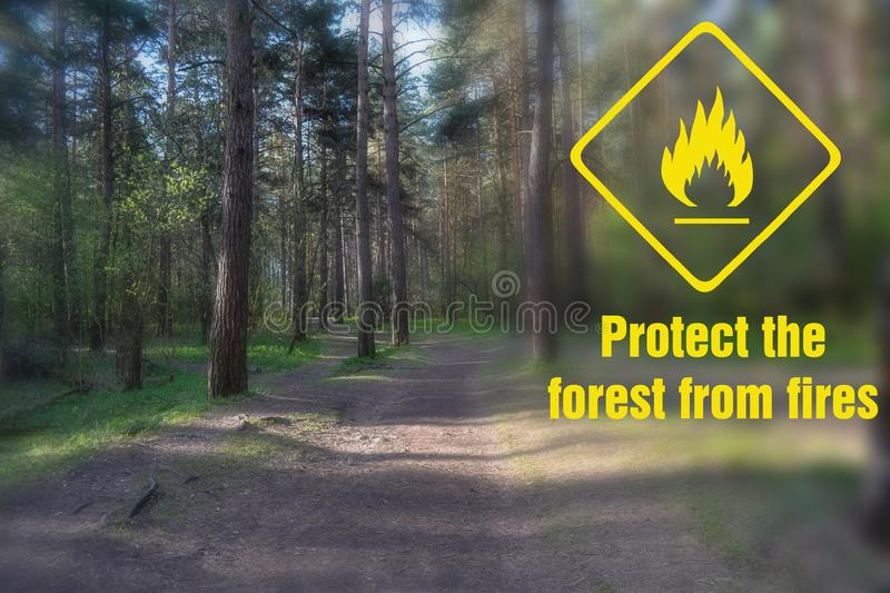 Caption: protect the forest from fire. And a sign of fire danger royalty free stock photo