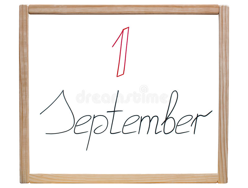 Caption ' 1 September ' is written in red and black marker on a school, white board. In a wooden frame on an isolated, white background stock illustration