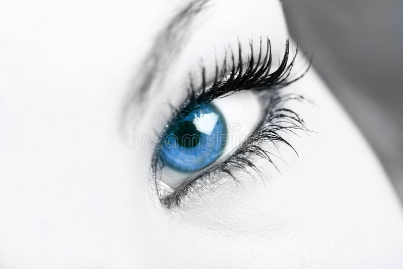 Captivate. Selective color on blue eye stock photo
