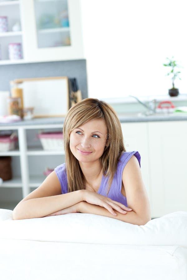 Captivating Caucasian Woman Sitting On A Sofa Royalty Free Stock Photos