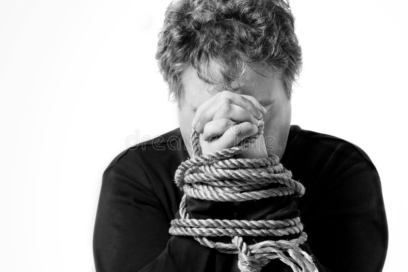 Captive. Black and white image of a man with his hands tied