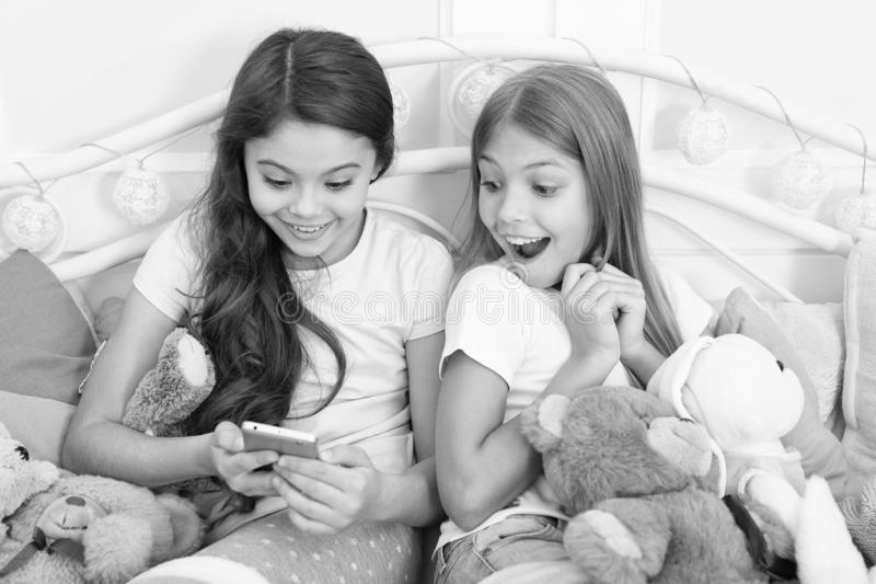 Capture happy moment. Girlish leisure happy childhood. Girls with smartphone use modern technology. Lets take selfie stock photo