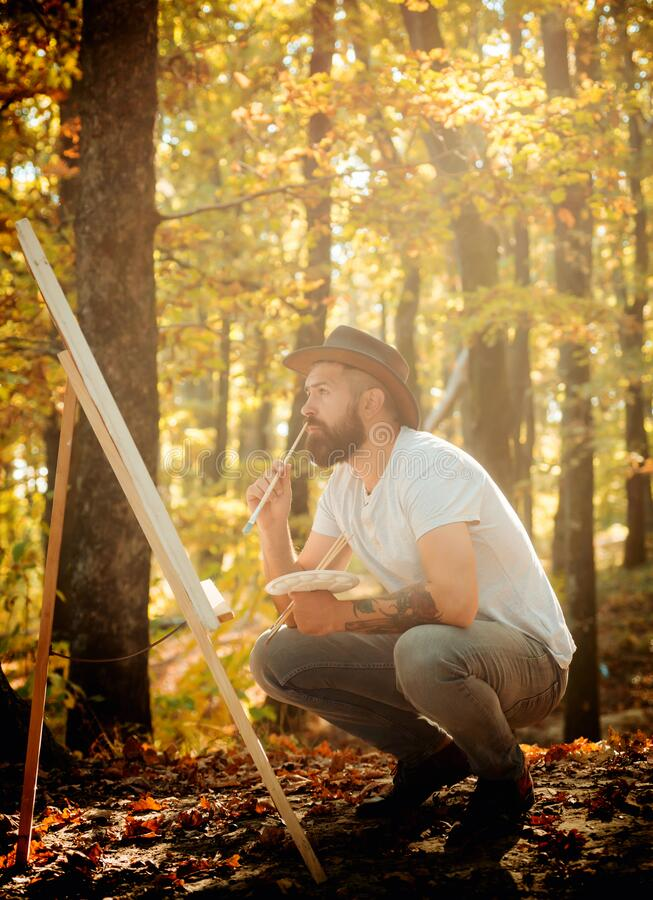 Capture moment. Bearded man painter looking for inspiration autumn nature. Drawing from life. Painter artist forest. Art. Concept. Painting in nature. Start new stock photos