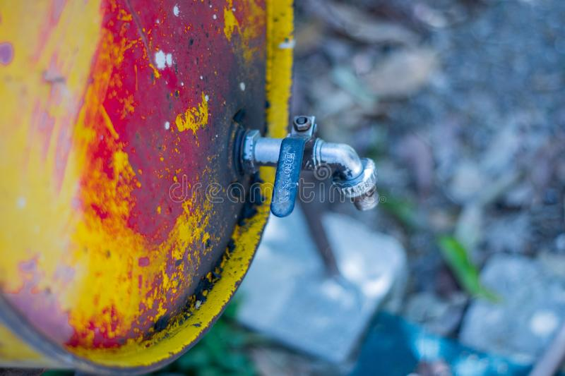 Metal oil barrel with a taps royalty free stock images