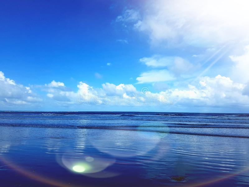 Capturing the sea under the Blue Sunny Sky. Blue sky bright sun sunny risinv rising aky capturing royalty free stock photos