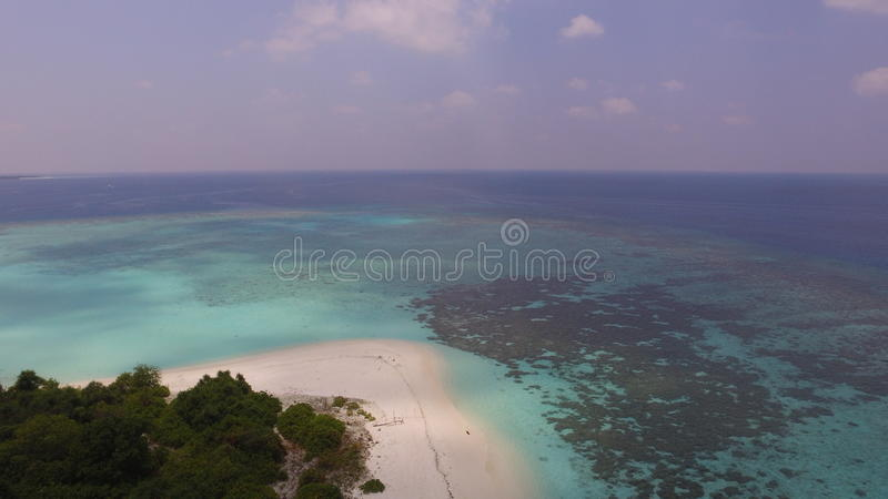Capturing shadow of the clouds. Sandy beaches in Maldives tropical island royalty free stock images