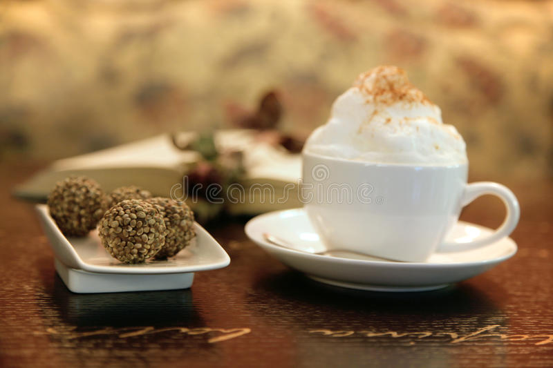 Capuccino Cup With Truffles Stock Photography
