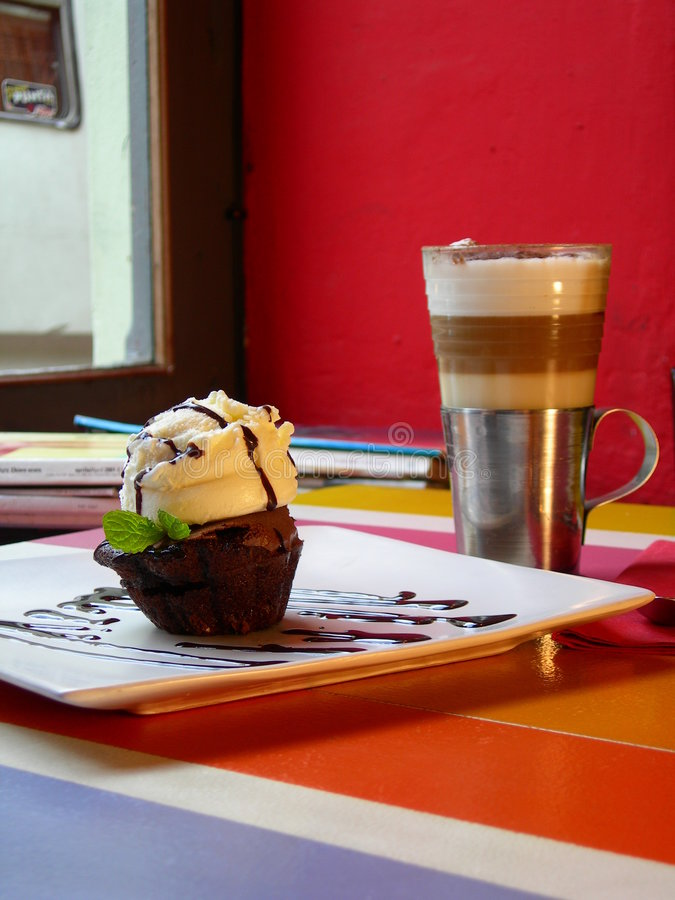 Capuccino with ice muffin royalty free stock photography