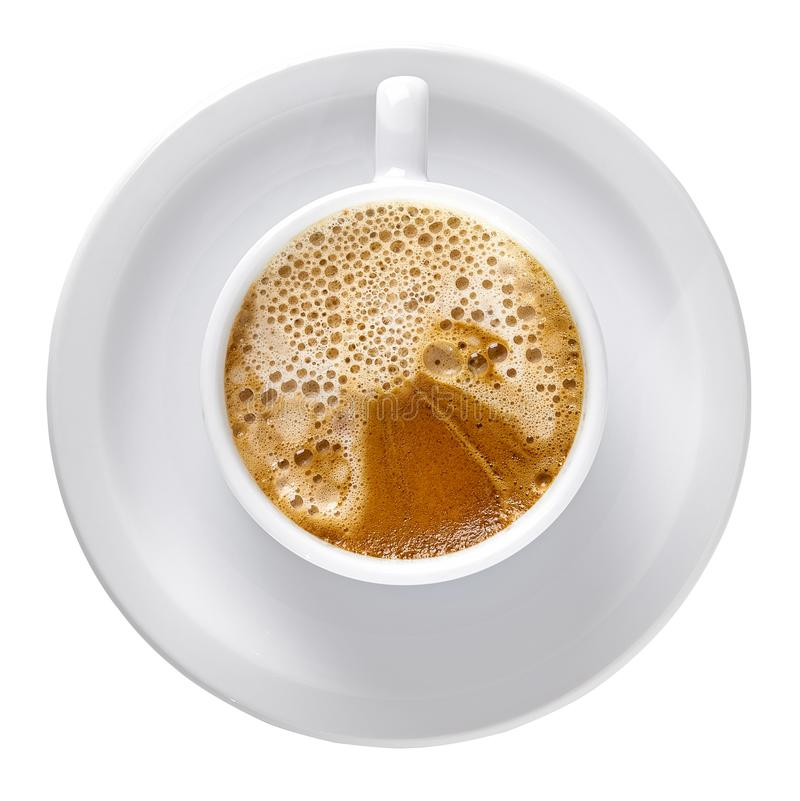 Capuccino in porcelain cup. And white plate from top view  isolated on white background including clipping path royalty free stock image